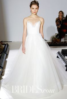 Brides.com: . Style 8666, ivory tulle ball gwon, Alencon lace bodice, sweetheart neckline with thin straps, sheer tulle crisscross back, lace detail on skirt, Jim Hjelm