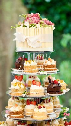 Naked miniature cakes are adorable on this gate tower #adorable #cakes #miniature #naked #tower
