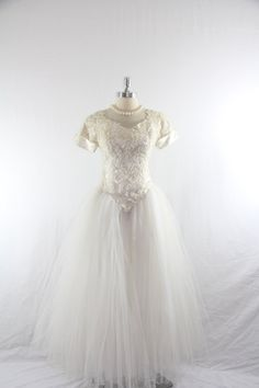 1980's does 1950's  Vintage Wedding Dress - Iovry Beaded Lace and Satin Wedding Gown. $190.00, via Etsy.