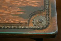 Here's a unique coffee table found at thrift shop. Really like the old gears and bicycle chain inlaid Here's a unique coffee table found at thrift shop. Really like the old gears and bicycle chain inlaid… interiordecordesi… Metal Furniture, Industrial Furniture, Diy Furniture, Business Furniture, Outdoor Furniture, Wood Steel, Wood And Metal, Metal Art, Metal Projects