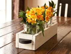 """Beautiful, handcrafted, rustic and oh so functional! These solid wood table caddy/centerpiece boxes are the perfect accessory to your table décor! Handcrafted with quality pine wood, each piece is hand cut, lightly sanded and richly stained. The box is finished with a durable sealer highlighting the wood characteristics in all its natural beauty! 2 handmade handles are added for a unique look.Available in 2 luxurious colors: Aged White and Brown.Box Dimensions: 21""""L x 5""""W x 3.5""""H Insid..."""