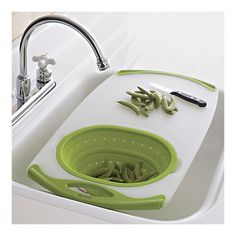 Over-the-sink cutting board and strainer from Crate an barrel. Genius. I want!