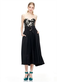 The Electra bodice by Kate Sylvester features a beautiful floral brocade, bust detailing and exposed back zip.Main: 100% Polyester. Lining: 100% Polyester. Delicate short cycle dry clean only. Select your dry cleaner with care. Model is wearing a size small. Model also wears Sasha skirt & Lurex socks.