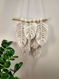 This artwork is handcrafted with unbleached, beige color 100 % cotton rope attached to a pine dowel. This Macrame wall hanging is a perfect addition to any wall in your home! This panel will add comfort to your home. It will be perfect home decor for Minimalist, Scandinavian, Loft, Art Macramé, Art Mural, Boho Dorm Room, Yarn Wall Art, Boho Wall Hanging, Hanging Banner, Hanging Artwork, Ideias Diy, Macrame Projects