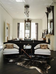 Michelle James home in NY. This space is moody! The large ornate mirrors, exaggerated case, fixture and palette are incredible