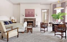In the master bedroom of a Boston residence, a 1950s Austrian pendant light from Eric Appel is juxtaposed with late-19th-century Moorish chairs and a 1920s armchair attributed to Paul Poiret's Atelier Martine from Bernd Goeckler Antiques; the carpeting was custom made by Tai Ping.  ARCHITECT: Dell Mitchell Architects DESIGNER: Thad Hayes Inc. PHOTOGRAPHER: Pieter Estersohn