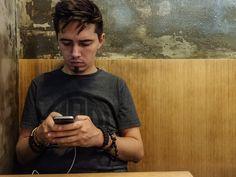 Karl checking his phone, Hong Kong