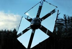 "A what? A heliostat ""is a device that includes a mirror, usually a plane mirror, which turns so as to keep reflecting sunlight toward a predetermined target, compensating for the sun's apparent motions in the sky."" Source: Clean Technica (http://s.tt/19yPY)"