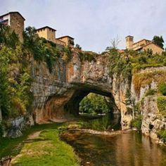 Puentedey (Burgos, Spain) is a little village perched on an amazing natural bridge carved by the river Nela. The village lies on the rocks topped by a Romanesque church and the palace of Porres. We can also find the typical traditional architecture. Beautiful Places In Spain, Beautiful Sites, Wonderful Places, Places To Travel, Places To See, Magic Places, Spain And Portugal, Roadtrip, Spain Travel