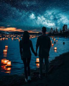 Awww cute couple enjoying the nightlife by the beautiful lights and water