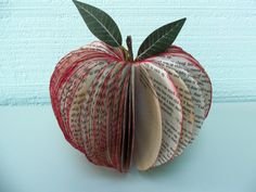 Hey, I found this really awesome Etsy listing at http://www.etsy.com/listing/118103707/book-art-apple