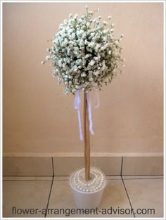 Would be very pretty at ceremony; could bring into reception afterward.  Foam ball secured on stick; cover with  gypsophilia, add ribbons, pearls.