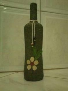 garrafa decorada com folha seca