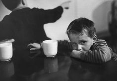"""Caption from a LIFE story on Ellis Island, 1950: """"Tired child is ready to go to sleep with his head on the dining-hall table. American food is sometimes too strange for aliens. There is a kosher kitchen for orthodox Jews.""""  (Alfred Eisenstaedt—Time & Life Pictures/Getty Images)"""
