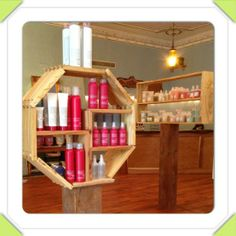 The Davines product display at the Willow Room Salon, Lakewood, Ohio, USA. The product shelves are handcrafted from local reclaimed lumber.