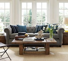 Gray sofa with blue accent pillows and natural fiber rug. Refresh and organize your living room for the new year.