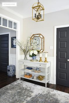 Elegant Spring decorating using pretty blue and vibrant yellow accents along with real and faux florals to help bring a sophisticated yet relaxed feel to your home. #springdecorating #springdecor #springentryway #entryway