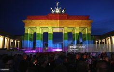 The Brandenburg Gate is seen with a rainbow flag projected onto it during a vigil for victims of a shooting at a gay nightclub in Orlando, Florida nearly a week earlier, in front of the United States embassy on June 18, 2016 in Berlin, Germany. Fifty people were killed and at least as many injured during a Latin music event at the Pulse club in the worst terror attack in the U.S. since 9/11. The American-born gunman had pledged allegiance to ISIS, though officials have yet to find…