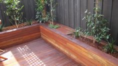 decking with planter boxes, but I want seats in front of it, that are integrated into the deck :)