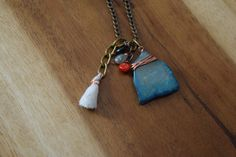 Wire-wrapped Stone Pendant and Tassel Necklace by RamblingWhimsy