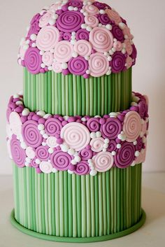 I just love how they used simple fondant swirls, beads, and rods to create a flower bouquet cake.