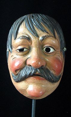 """Folk Mask. Garmisch Parten Kirchen, Bavaria. igned by a mastercarver with the innitials """"LH,"""" this peasant man has been expertly carved without files or sandpaper, and it is quite thin and light weight, in the great tradition of German folk art."""