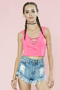 A sleeveless knit crop top with grommet-accented crisscross straps at its plunging neckline.