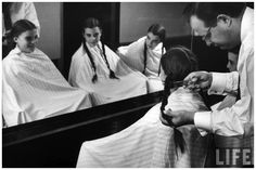 Triplets Christina Dees (L), Katha Dees (C) and Megan Dees modeling their braids before getting hair cuts Nina Leen 1956 LIFE |