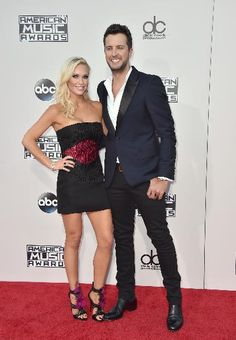 Luke Bryan, from right, and Caroline Boyer arrive at the American Music Awards at the Microsoft Theater on Sunday, Nov. 22, 2015, in Los Angeles.