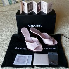 """CHANEL Pink Platform Mules (38 Euro) These gently used CHANEL mules are just adorable! Folded baby pink leather with maroon acrylic bottoms (?). 4"""" heel with inclined platforms 0.25""""-0.5"""". Show some light scuffs, the heel inserts need to be replaced (original pair included) & 1 shoe is missing baby pink CC logo. It's hardly noticeable, but I intended to have my shoe repair store modify both using the silver CC logo earrings I also have listed on Posh. Original box, individual shoe dust bags…"""
