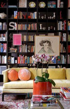 ooooh my goodness dark bookshelves, yellow sofa. I WANT A YELLOW SOFA!