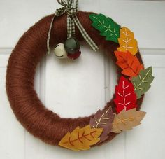 Yarn Wreath Falling Leaves Front door 12 by AnnaHailey on Etsy Fall Yarn Wreaths, Felt Flower Wreaths, Felt Wreath, Diy Wreath, Holiday Wreaths, Felt Flowers, Halloween Yarn Wreath, Wreath Ideas, Autumn Crafts