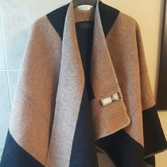 Hottest item! Burberry prorsum mega cape Hottest item this year. Brand new. Burberry prorsum mega cape. Super soft and warm. Solid camel color with black trim. Made with material and labels exactly the same. Used my own as airport attire recently. Burberry Jackets & Coats Capes
