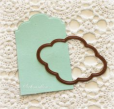 make a decorative border tag using part of a die