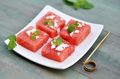 Melon shapes with mint and feta from Anja's food 4 thought. Cut melon into 1 1/2 inch thick slices. With cookie cutters of your choice cut, shapes out of the slices. Sprinkle with a little crumbled feta cheese and garnish with fresh mint leaves. Serve ice-cold.