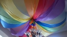 Candyland...ceiling...dollar store plastic tablecloths!!!   dollar treasure (store) has every color!  =)