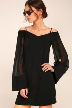 Make an entrance to remember in the C/MEO Presence Black Long Sleeve Off-the-Shoulder Dress! Double skinny straps support sheer, long, off-the-shoulder sleeves with a slit, and covered button cuffs. Relaxed bodice with an off-center loop button placket.