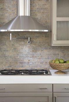 kitchens - pot filler tumbled linear stone tiles backsplash taupe gray kitchen cabinets white quartz countertops  Gorgeous modern  kitchen design  #CambriaQuartz