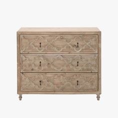 Our Carlsbad Entry Cabinet is constructed from beautiful reclaimed pine with a subtle grey finish. Features three intricately carved drawers.