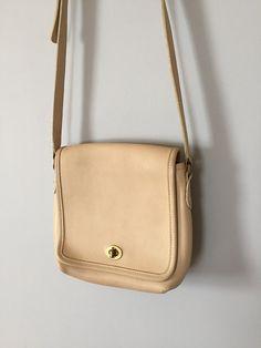 COACH messenger bag nude leather Coach purse brass turn . adrian company