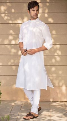 Kurta Styles To Make You The Best Dressed Guy is part of Kurta style - Planning to be the hot topic at special occasions like festivals and wedding Here are kurta styles to make you the best dressed guy Wedding Kurta For Men, Wedding Dresses Men Indian, Wedding Dress Men, Gents Kurta Design, Boys Kurta Design, Indian Men Fashion, Mens Fashion Wear, Kurta Pajama Men, Kurta Patterns