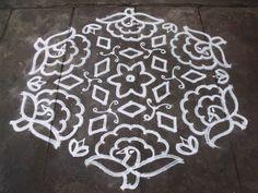 Rangoli designs/Kolam: S.No. 75 :- 17-9 pulli kolam - interlaced dots kol...