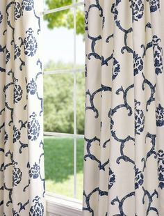 curtains - I would love to tie in this color blue with the pale yellow and creams.