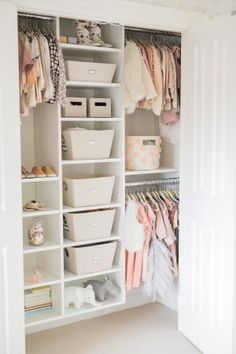 This toddler room is a little girl's dream with a blush pink and ivory color palette, beautiful wallpaper and cozy accents.