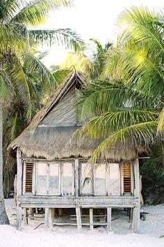 #Tulum, #Mexico hut among palm trees