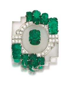 ROCK CRYSTAL, EMERALD AND DIAMOND BROOCH, 1930S Of geometric design, decorated with panels of frosted rock-crystal, accented with carved emerald leaves and circular-cut diamonds, French import marks, fitted case.
