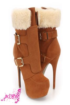 You will be head over heels for these saucy little numbers! They will perfectly compliment any outfit for any occasion! Make sure to add these to your collection, they definitely are a must have! The features for these booties include a faux suede upper with a faux fur trim, straps and buckle accents, stitched detailing, round closed toe, smooth lining, and cushioned footbed. Approximately 6 inch heels and 2 inch hidden platforms.