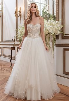Justin Alexander. Beaded Venice lace and tulle ball gown with a sweetheart neckline.