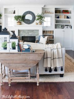 Lake House Living Room Decor with layered rugs by The Lilypad Cottage. Love the fireplace wall with the tiny windows! Decor Home Living Room, Living Room Carpet, Rugs In Living Room, Home And Living, Small Living, Modern Living, Rug Over Carpet, Stair Carpet, Kitchen
