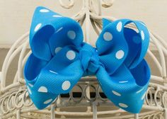 Handcrafted Polka Dot Boutique Bow.  Island blue hair bow with dots.